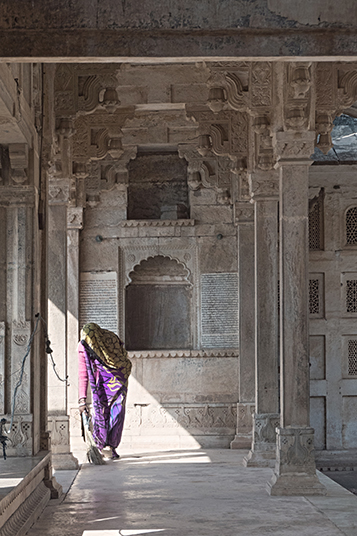 Indian woman sweeping the fort at Bundi