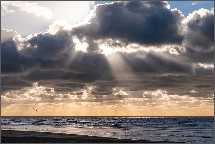 sun setting over the sea at Le Touquet, Northern France.
