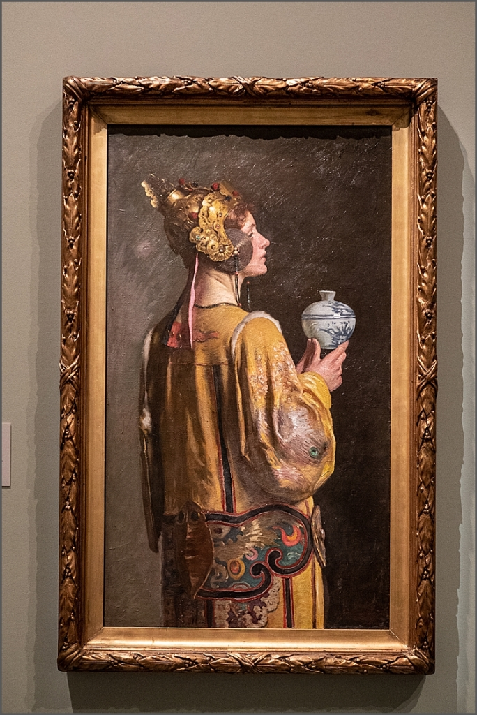 Painting of a woman holding vase in The National Gallery Victoria.